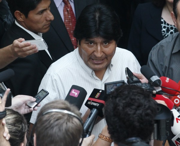 Bolivian President Evo Morales talks to journalists at the Vienna International Airport in Schwechat July 3, 2013. Morales said on Wednesday he was awaiting Spanish permission to fly home through its airspace after he refused Madrid's request to inspect his plane following its diversion to Vienna. France and Portugal abruptly cancelled air permits for Morales' plane en route from Moscow on Tuesday, apparently due to fears fugitive ex-U.S. spy agency contractor Edward Snowden could be on board. Bolivian and Austrian officials denied this.