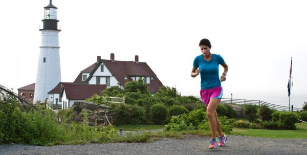 Cape Elizabeth resident Martha Kelley runs past Portland Head Light on a humid, foggy morning. Kelley, who has participated every TD Beach to Beacon 10k, is training for the 16th race on Saturday, Aug. 3. She hopes to finish the 6.2-mile run in 48 minutes, but said she might lose some time if the weather is particularly humid. About 100 medical volunteers will be at the race to treat runners with heat-related or other illnesses.