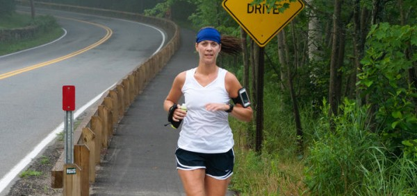 Portland resident Andrea McGowan trains Wednesday morning for the TD Beach to Beacon 10k on Shore Road in Cape Elizabeth. McGowan, who has run in eight of the annual races, said conditions are generally hot and humid on race day, which can make the 6.2-mile course grueling.