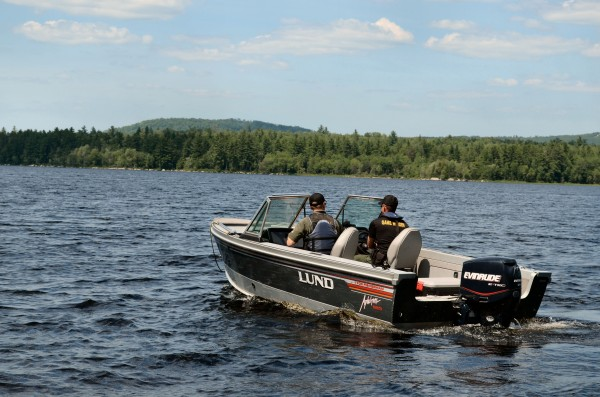 Two Maine Warden Service members ride in a boat on Monday toward the area on Great Moose Lake in Hartland where a man has been missing since Sunday night.
