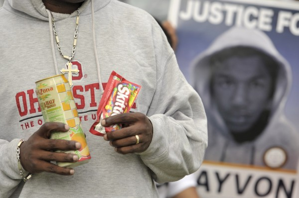 A demonstrator holds a bag of Skittles candy and Arizona iced tea, similar to items Trayvon Martin purchased the night he died, as he demonstrates outside Seminole County Court in Sanford, Fla., Friday.