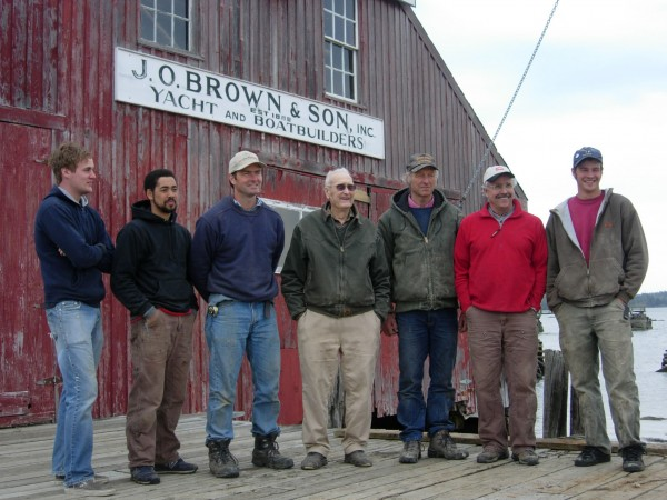 The Brown family continues to operate the 125-year-old island boatyard. The family members include those in this 2007 photograph: Adam Alexander (second from left), James Everett Brown (center), Foy Everett Brown (third from left), and Foy Weld Brown (third from right).