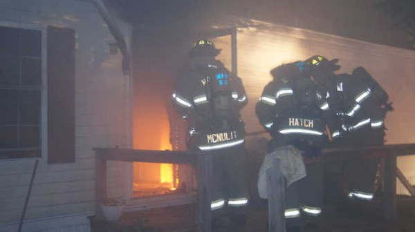 Norway firefighters worked early Wednesday to extinguish a mobile home fire that began with a knocked-over oil lamp.