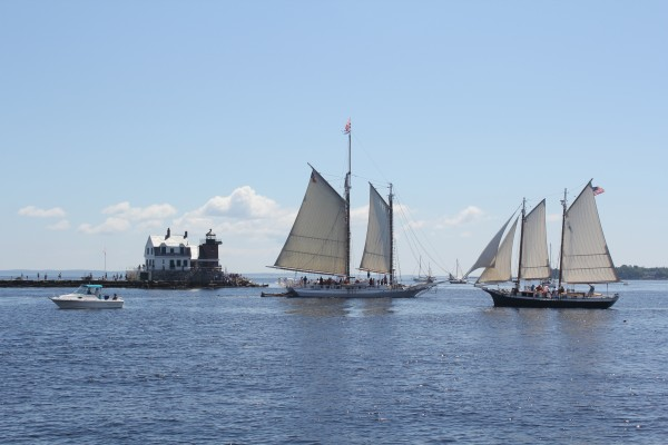 Boats lined up at the Breakwater Lighthouse for the Great Schooner Race in July 2012.