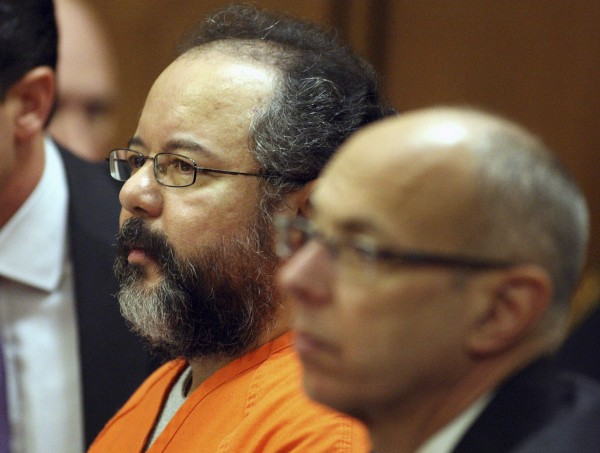 Ariel Castro, 53, sits in the courtroom next to his attorney Jaye Schlachet, right, in Cleveland, Ohio July 26, 2013.  Accused Cleveland kidnapper Castro agreed on Friday to plead guilty and serve life in prison without parole for the abduction and abuse of three women over about a decade.