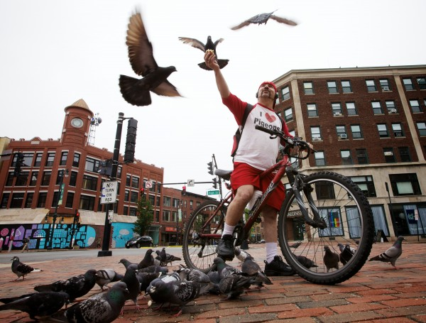 Starr Sarabia greets his winged friends in Portland's Congress Square while on his almost daily bike ride before going to work.