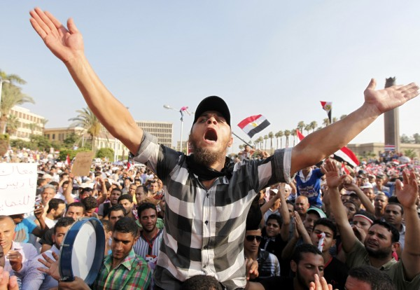 Members of the Muslim Brotherhood and supporters of Egyptian President Mohamed Mursi shout slogans and wave Egyptian flags during a protest around the Raba El-Adwyia mosque square in Nasr City, in a suburb of Cairo July 2, 2013. Egypt's army reprised its role as hero in a new act of the country's political drama on Monday with a move celebrated by protesters as a decisive blow against an unpopular president just two and half years after the military unseated his predecessor.