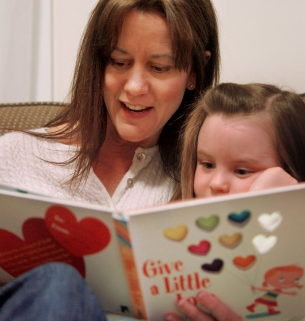 Bangor lawyer Carolyn Adams reads to her daughter Hazel Dow, 4, before tucking her into bed. Adams received the guardian ad litem award from Adoptive and Foster Families of Maine in 2008 for her work as a child protection lawyer.