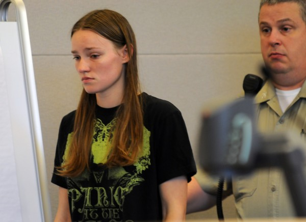 Leanna Norris is shown into court on Friday, July 5, at the Penobscot Judicial Center  for her arraignment on murder charges in connection with the death of her daughter Loh Grenda.