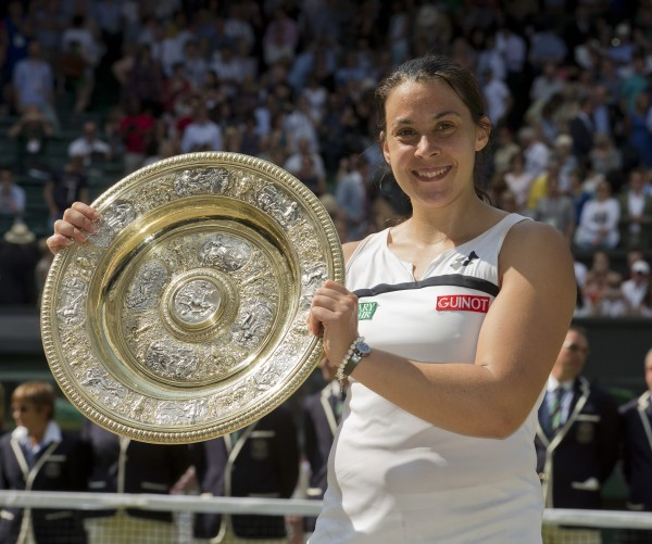 Marion Bartoli of France holds her trophy, the Venus Rosewater Dish, after defeating Sabine Lisicki of Germany in the women's singles final Saturday at the Wimbledon Tennis Championships in London.