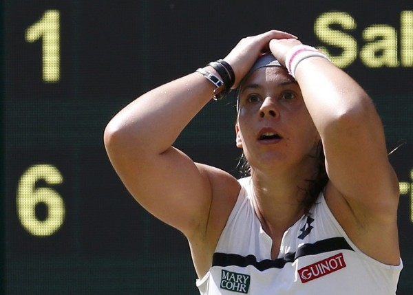 Marion Bartoli of France reacts Saturday after defeating Sabine Lisicki of Germany in the women's singles final at the Wimbledon Tennis Championships in London.