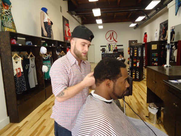 Barber Frank Crosen, shown updating Korey Barnes' look, is bringing back the old-fashioned art of barbering at Momentum in Portland.