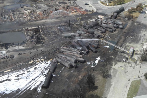An aerial view of burnt train cars after a train derailment and explosion in Lac-Megantic, Quebec July 8, 2013 in this picture provided by the Transportation Safety Board of Canada. The driverless, runaway fuel train that exploded in a deadly ball of flames in the center of the small Quebec town started rumbling down an empty track just minutes after a fire crew had extinguished a blaze in one of its parked locomotives, an eyewitness said on July 8, 2013.