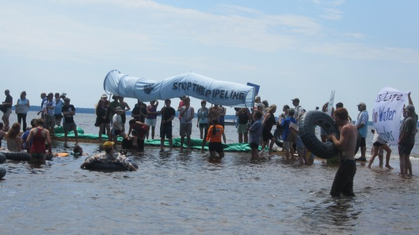 Protesters organized a &quotPeople's Flotilla&quot at Sebago Lake State Park Saturday, part of an event designed to protest the transportation of so-called tar sands crude oil through the Portland Pipeline, which passes by a cove of the lake.