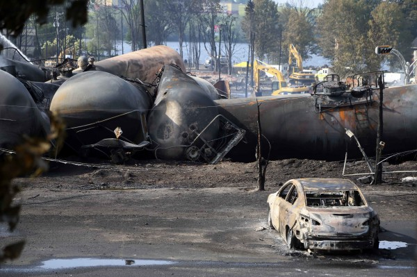A burnt-out vehicle sits near the wreckage of a train car following a train derailment in Lac-Megantic, Quebec, on Sunday.