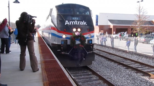 The first trip of the Amtrak Downeaster's new passenger train service from Boston to Freeport and Brunswick arrives at Brunswick's Maine Street Station in November 2012.