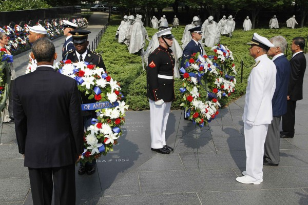 U.S. President Barack Obama (left, back to camera) along with U.S. and South Korean dignitaries lay wreaths on the 60th anniversary of the end of the Korean War, at the Korean War Veterans Memorial in Washington on Saturday. Military commanders representing North Korea, China and the United States signed the armistice on July 27, 1953, setting up a 150 mile border across the peninsula that is the world's most heavily guarded frontier.