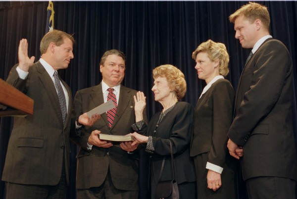Vice President Al Gore (left) swears in Lindy Boggs as ambassador to the Vatican, in Washington in this Nov. 12, 1997, file photo. With Boggs are her son Tommy Boggs, holding Bible, her daughter Cokie Roberts and her grandson Paul Sigmund.  Boggs, who took over her husband's congressional seat to become a crusader for women's equality and civil rights, died July 27, 2013, at 97.