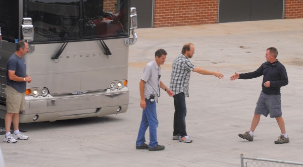 Phish member Page McConnell (second from right) arrives at the Cross Insurance Center.