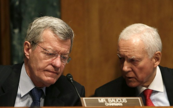 Senator Max Baucus, D-Mont. (left), the chairman of the Senate Finance Committee, and Senator Orrin Hatch, R-Utah, the co-chair, confer during testimony in Washington May 21, 2013.