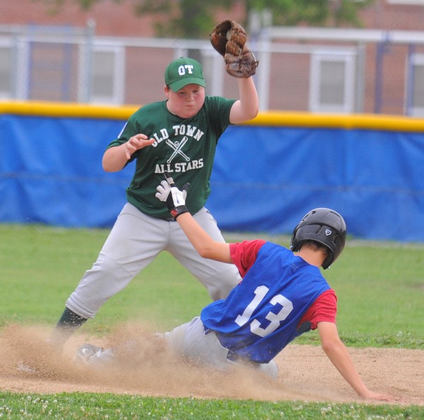 Bangor West's Tyler Carmichael (right) slides to second base beating the tag by Old Town's Hunter Brasslett during a District 3 Little League all-star game in Bangor Monday afternoon.