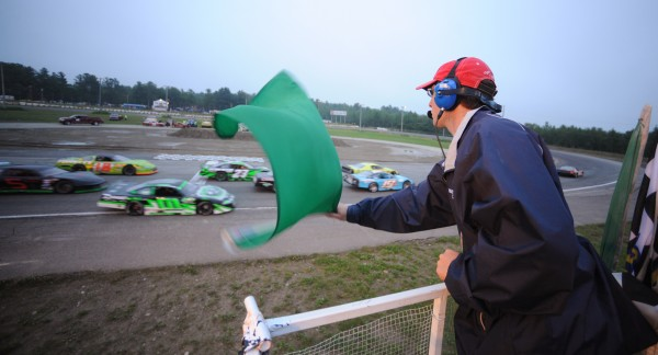 Flagman Jordan Harnish starts the Dysart's Late Model 40 lap race at Speedway 95 in Hermon on Saturday night. Ryan Modery of Hermon won that race.