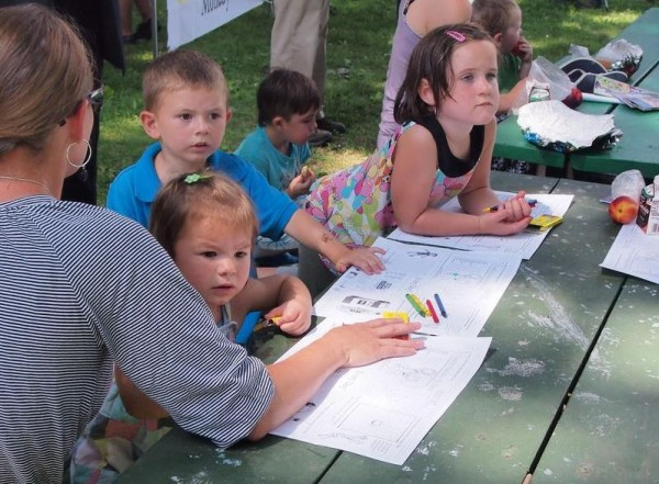 Amy Arris watches her kids, Caleb and Chole, right, and a friend's child, Paisley Damon, at a July 24 Deering Oaks Park event promoting Portland's summer meals program. Food service Director Ron Adams estimated participation in the program has doubled since last year.