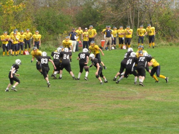 The Medomak Panthers (in yellow) play the Milo Patriots (in black). Courtesy of Greater New England Youth Football League