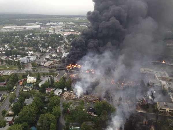 Smoke billows from a fire at the site of a train derailment in Lac-Megantic, Quebec, on Saturday, July 6. Several people were reported missing after four tank cars of petroleum products exploded in the middle of the small town in a fiery blast that destroyed dozens of buildings.