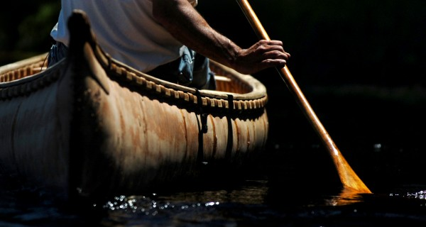 Barry Dana paddles a traditional birch bark canoe built with all natural materials in this 2006 file photo.  The Penobscot people would have used such vessels for thousands of years to travel on the waterways of rivers, lakes and along the coast in Maine.