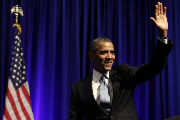 U.S. President Barack Obama waves after delivering remarks at an Organizing for Action dinner in Washington July 22, 2013.