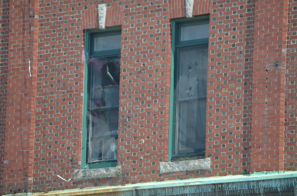 The windows shot out at 47 Park Street in Bangor. An unidentified man was arrested after allegedly shooting 70 or more bullets out of a window on Park Street on Thursday, July 4, 2013. No one was injured.