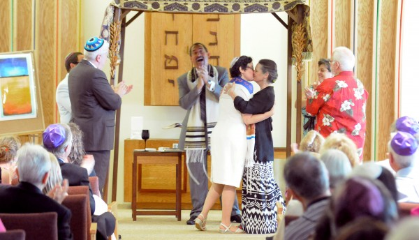 Rabbi Darah Lerner (left) and her spouse Kelly Quagliotti kiss at the end of their wedding ceremony at Congregation Beth El in Bangor Sunday afternoon.