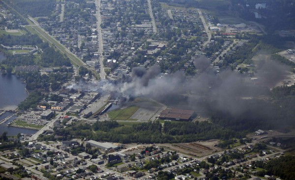 Smoke rises after a train explosion in the town Lac Megantic July 6, 2013. Several people were missing after four tank cars of petroleum products exploded in the middle of a small town in the Canadian province of Quebec early on Saturday in a fiery blast that destroyed dozens of buildings.