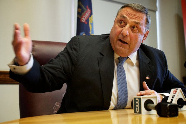 Governor Paul LePage reacts to his overridden budget veto last month in Augusta.