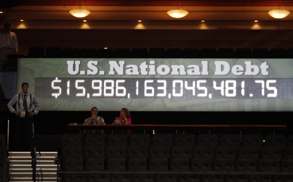 The national debt clock is started during the first day of business at the 2012 Republican National Convention on Monday, August 27, 2012, at the Tampa Bay Times Forum in Tampa, Florida.
