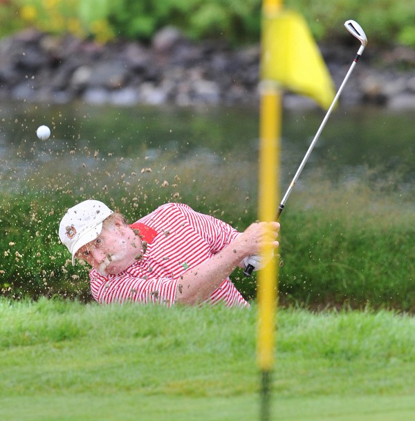 Mark Plummer blasts out of the ninth-hole bunker onto the green, leaving it just a few inches short of the hole during Thursday's final round of the Maine Amateur Championship at the Augusta Country Club in Manchester.  The 62-year-old Plummer finished seventh.