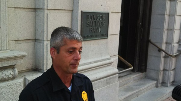 Bangor Police Sgt. Paul Edwards speaks with media outside Bangor Savings Bank on State Street on Wednesday.