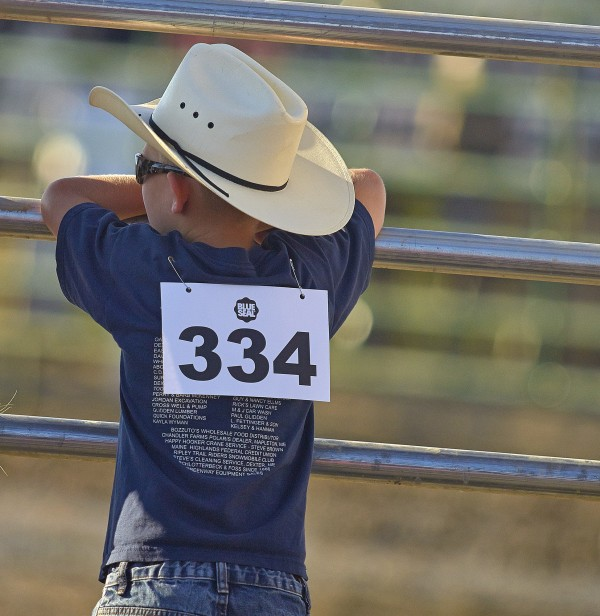 Kholton Perry, Mutton Busting competitor, watches the arena preparation for the rodeo events at the Maple Lane Farm in Chaleston on Saturday. BDN photo by Michael York