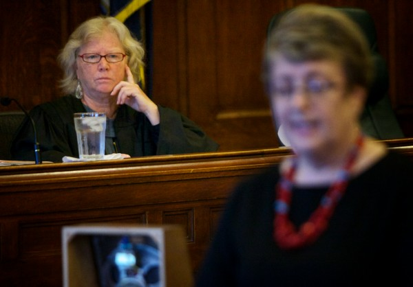 Justice Joyce Wheeler listens to opening arguments during the first day of Eric Gwaro's trial Tuesday morning in Cumberland County Unified Criminal Court in Portland.