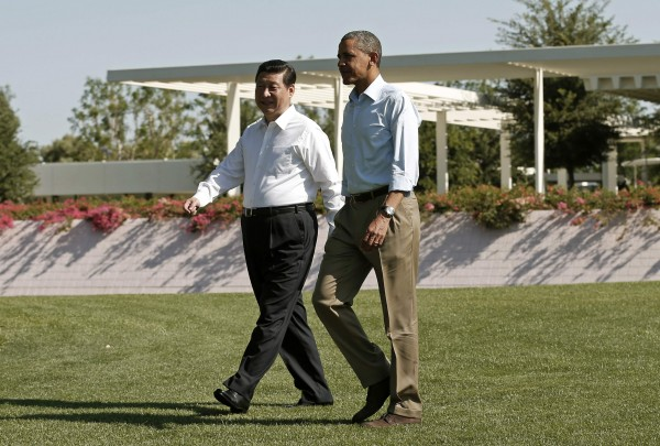 U.S. President Barack Obama and Chinese President Xi Jinping walk the grounds at The Annenberg Retreat at Sunnylands in Rancho Mirage, California June 8, 2013.
