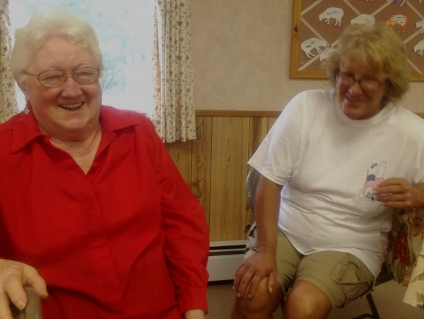 Lorriane Yeaton and Melinda Williams chat at Acton Congregational Church.