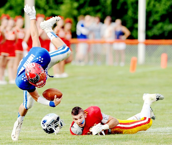 Lawrence High School defensive back Spencer Carey's helmet flies off after tripping up quarterback Dillon Russo of Scarborough High School during the Maine Shrine Lobster Bowl Classic in Biddeford on Saturday. Carey plays for the East and Russo plays for the West.