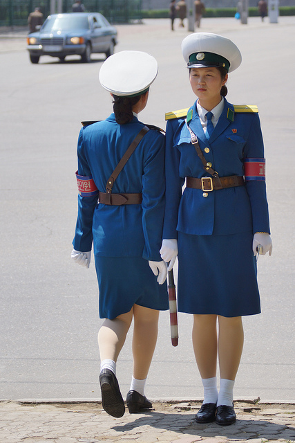 Traffic girls perform a changing of the guard in Pyongyang, North Korea.