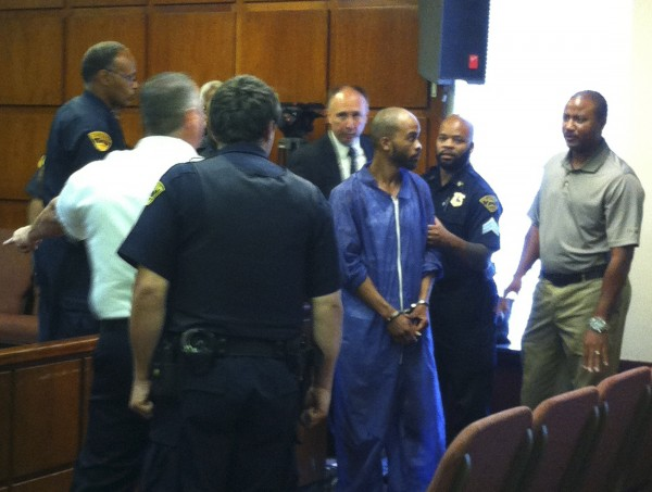 Michael Madison, suspected of killing three women, handcuffed and wearing a gauzy purple jumpsuit, is pictured during an appearance in East Cleveland Municipal Court in East Cleveland, Ohio, July 22 ,2013.