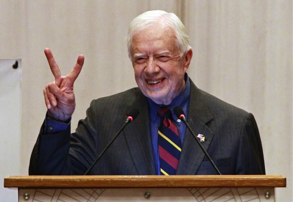 Former U.S. President Jimmy Carter gestures before delivering a speech at a hotel in Yangon on April 5, 2013.