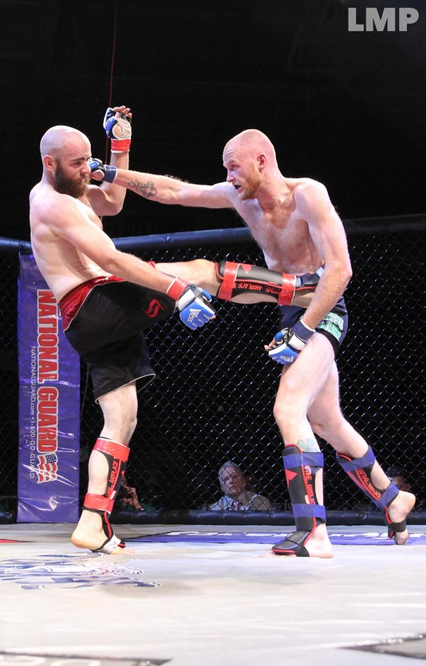Buck Pineau (right) lands a right-hand strike to Allan Josselyn during their middleweight mixed martial arts bout at Lewiston on May 18. Pineau won by unanimous decision.