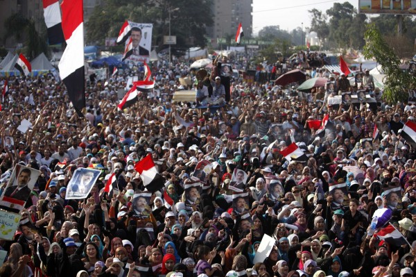 Supporters of deposed Egyptian President Mohamed Morsi shout slogans as they rally at the Raba El-Adwyia square where they are camping in Cairo July 8, 2013.