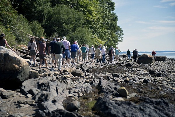 A group of people participate in a geology walk, one of the many events of Governor Baxter Day on Aug. 22, 2012, in Portland.