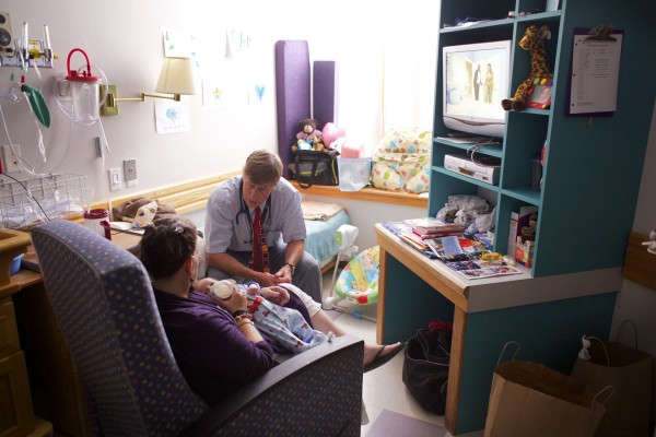 Eastern Maine Medical Center's Dr. Mark Brown talks to a 1-month-old baby's mother while showing the pediatric patient room at EMMC on Wednesday afternoon in Bangor.